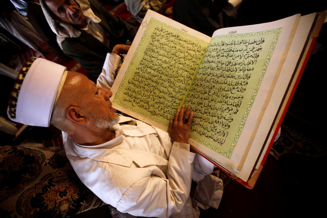 A man reads the Koran at the Grand Mosque during the holy fasting month of Ramadan in Sanaa, Yemen, June 24, 2016. (Photo by Mohamed al-Sayaghi/Reuters)