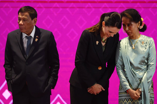 Myanmar's State Counsellor Aung San Suu Kyi (R) talks to New Zealand's Prime Minister Jacinda Ardern beside Philippines' President Rodrigo Duterte (L) during the 14th East Asia Summit in Bangkok on November 4, 2019, on the sidelines of the 35th Association of Southeast Asian Nations (ASEAN) Summit. (Photo by Manan Vatsyayana/AFP Photo)