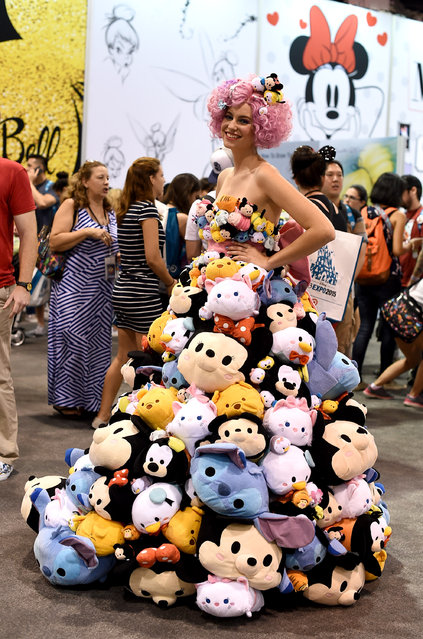 A model wears a one-of-a-kind dress made out of more than 300 Tsum Tsum plush commissioned by Disney Store for D23 Expo on Friday, August 14, 2015 in Anaheim, Calif. (Photo by Jordan Strauss/Invision for Disney Store/AP Images)