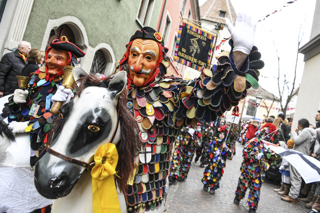 A group of fools attend a parade during the great fool's leap through the city centre of Konstanz, Germany, Sunday, February 23, 2020. (Photo by Felix Kaestle/dpa via AP Photo)