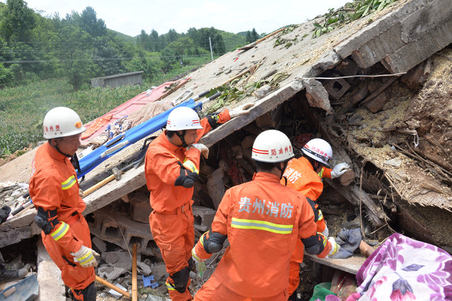 Rescue workers carry out a search at the site of a landslide in Bijie, Guizhou province, China, July 1, 2016. Picture taken July 1, 2016. (Photo by Reuters/Stringer)
