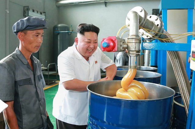 This undated picture released from North Korea's official Korean Central News Agency (KCNA) on August 5, 2014 shows North Korean leader Kim Jong-Un (C) inspecting the Chonji Lubricant Factory at an unconfirmed location. (Photo by AFP Photo/KCNA via KNS)