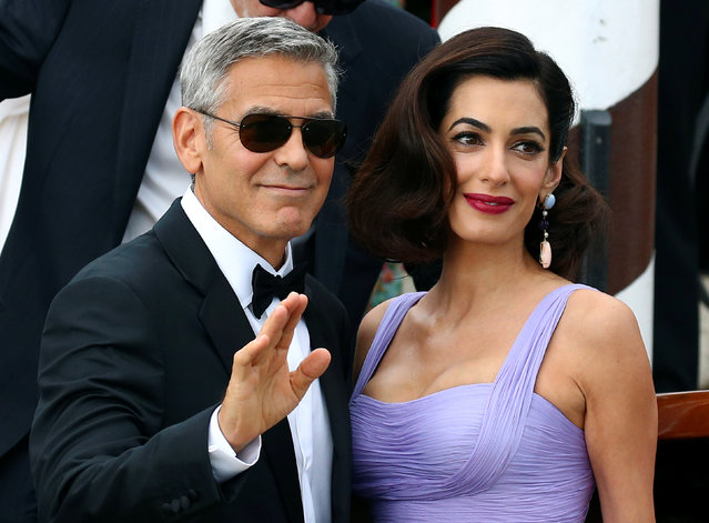 Actor and director George Clooney waves next to his wife Amal as they leave the hotel before the red carpet for the movie Suburbicon at the 74th Venice Film Festival in Venice, Italy on September 2, 2017. (Photo by Alessandro Bianchi/Reuters)
