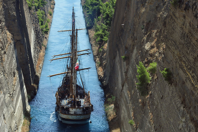 "The Italian three-masted training vessel ""Palinuro"", an iron-hulled barquentine, is crossing the Corinth Canal, Peloponnese, Greece, August 21, 2014. The Palinuro is active as sails trainings vessel for the Italian Navy. It was bought in 1951 by the Italian Navy as a replacement for the Cristoforo Colombo. The Palinuro is named after Palinurus the famous helmsman of Aeneas's ship. (Photo by Vasilis Psomas/EPA)"