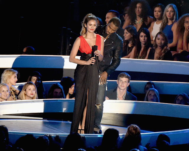 Actress Nina Dobrev (L) and recording artist Trey Songz speak onstage during the 2014 MTV Video Music Awards at The Forum on August 24, 2014 in Inglewood, California. (Photo by Michael Buckner/Getty Images)