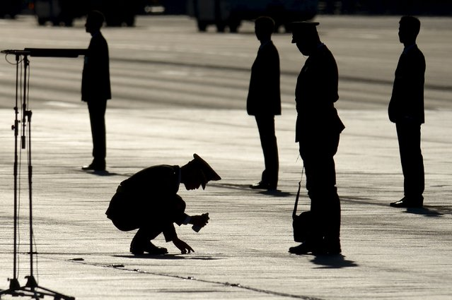 A Chinese soldier marks a spot on the ground at Tiananmen Square before the military parade marking the 70th anniversary of the end of World War Two, in Beijing, China, September 3, 2015. (Photo by Wang Zhao/Reuters)