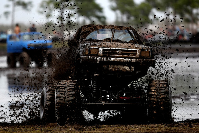Darren Nelsonof Dade City takes his Toyota pick-up through the mud bog. (Photo by Gary Coronado/The Palm Beach Post)