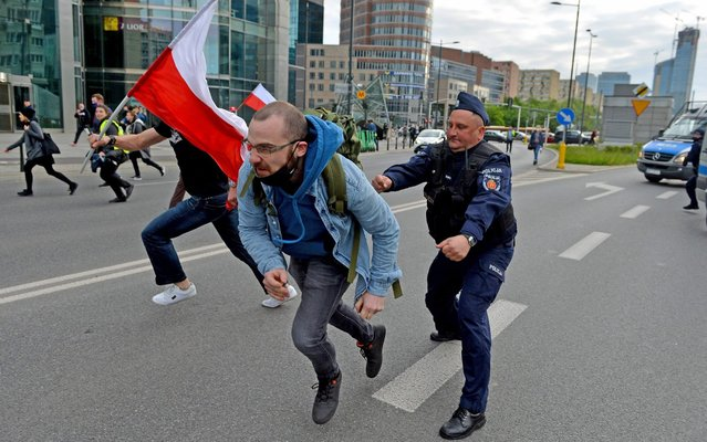 Riots during Entrepreneur Strike in Warsaw, Poland on May 16, 2020. Entrepreneurs went on strike against ruling party the PiS. Police used tear gas when the protesters tried go to the office of the ruling party. (Photo by Marcin Wziontek/Rex Features/Shutterstock)