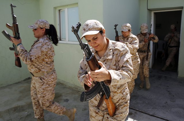Kurdish Peshmerga female fighters load magazines into their weapons during combat skills training before being deployed to fight the Islamic State at their military camp in Sulaimaniya, northern Iraq September 18, 2014. (Photo by Ahmed Jadallah/Reuters)