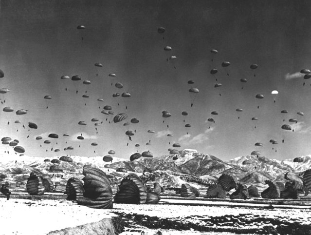 Men and equipment being parachuted to earth in an operation conducted by United Nations airborne units. Ca. 1951. (Photo by Defense Dept. (USIA))
