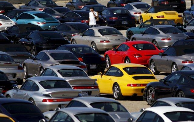 "A visitor walks through a ""corral"" of Porsche sports cars during the Porsche Rennsport Reunion V at Laguna Seca Raceway near Salinas, California, September 26, 2015. (Photo by Michael Fiala/Reuters)"