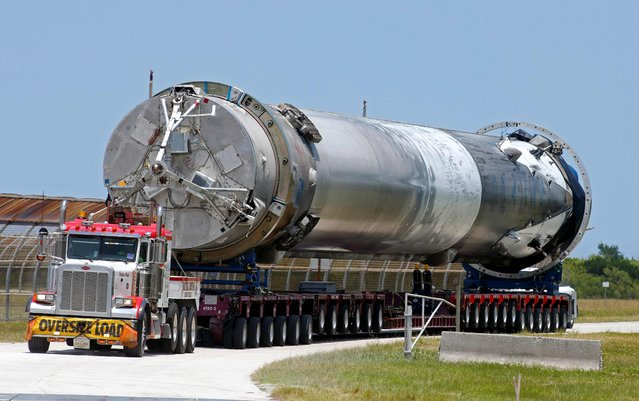 The recovered first stage of a SpaceX Falcon 9 rocket is transported to the SpaceX hangar at launch pad 39A at the Kennedy Space Center in Cape Canaveral, Florida May 14, 2016. (Photo by Joe Skipper/Reuters)