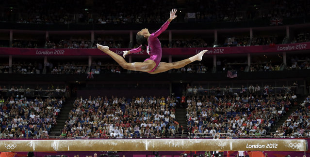 In this August 2, 2012 file photo, U.S. gymnast Gabrielle Douglas performs on the balance beam during the artistic gymnastics women's individual all-around competition at the 2012 Summer Olympics, in London. Douglas won the all-around competition. (Photo by Gregory Bull/AP Photo)