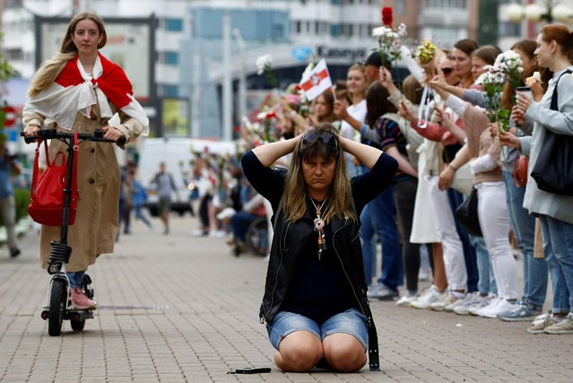 A woman kneels as she attends an opposition demonstration to protest against presidential election results in Minsk, Belarus August 22, 2020. (Photo by Vasily Fedosenko/Reuters)