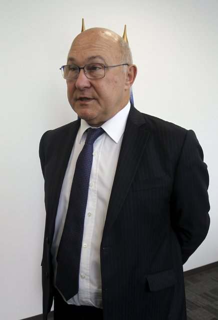 French Finance Minister Michel Sapin arrives to a news conference during the 2015 IMF/World Bank Annual Meetings in Lima, Peru, October 8, 2015. (Photo by Paco Chuquiure/Reuters)