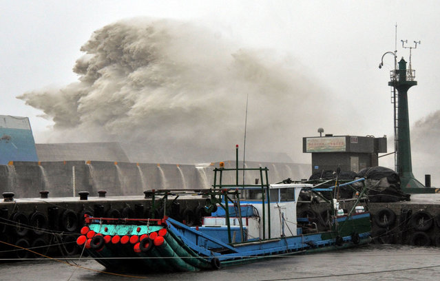 This photo by Taiwan agency CNA Photo shows a huge wave breaking over port infrastructure as super typhoon Meranti lashes a fishing port in southern Taitung county on September 14, 2016. (Photo by AFP Photo/Stringer)