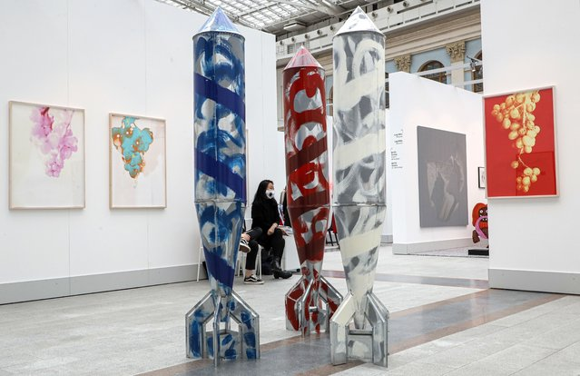 A woman seats near art works by Stano Filko on Galerie Emanuel Lay during the Cosmoscow international fair in Moscow, Russia, 10 September 2020. (Photo by Sergei Ilnitsky/EPA/EFE)