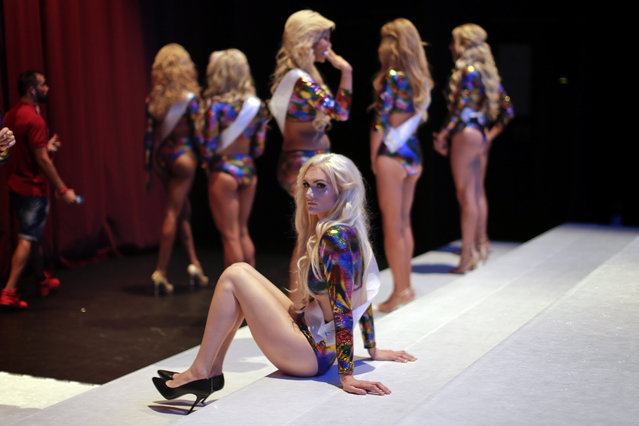 In this Sunday, September 18, 2016 photo, participants wait on stage ahead of Miss Trans Star International 2016 show celebrated in Barcelona, Spain. (Photo by Emilio Morenatti/AP Photo)