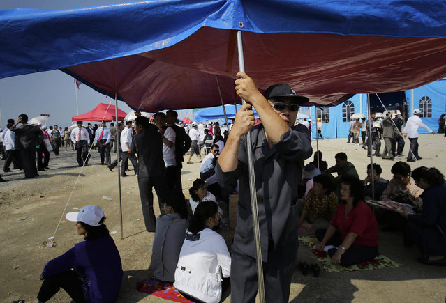 A North Korean man stands under the shade of a tent during an aerial display on Saturday, September 24, 2016, in Wonsan, North Korea. (Photo by Wong Maye-E/AP Photo)