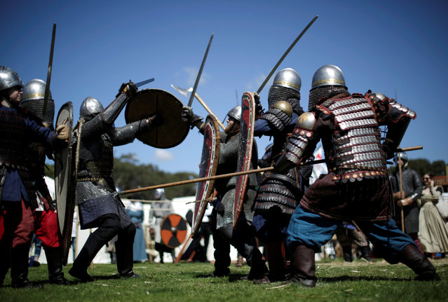 Participants dressed as medieval infantry fight a mock battle at the St Ives Medieval Fair in Sydney, one of the largest of its kind in Australia, September 24, 2016. (Photo by Jason Reed/Reuters)