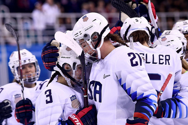 USA's Cayla Barnes (L) and USA's Hilary Knight embrace after winning the women's preliminary round ice hockey match between Finland and the US during the Pyeongchang 2018 Winter Olympic Games at the Kwandong Hockey Centre in Gangneung on February 11, 2018. (Photo by Brendan Smialowski/AFP Photo)