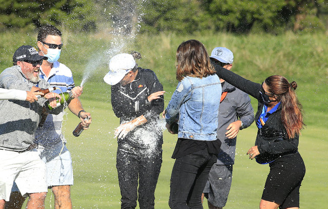 Mel Reid of England (C) is doused with champagne after winning the ShopRite LPGA Classic presented by Acer on the Bay Course at Seaview Hotel and Golf Club on October 04, 2020 in Galloway, New Jersey. (Photo by Michael Cohen/Getty Images)