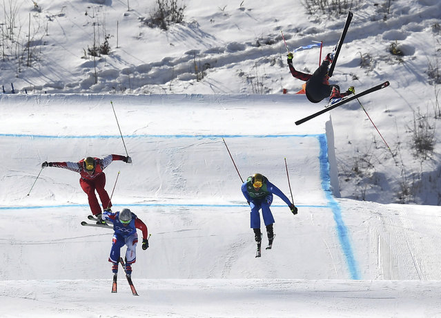 Christopher Del Bosco of Canada, right, flies through the air before crashing as Sergey Ridzik, Olympic Athletes of Russia, from left, Francois Place of France and Siegmar Klotz of Italy compete in the men's ski cross elimination round at Phoenix Snow Park at the 2018 Winter Olympics in Pyeongchang, South Korea, Wednesday, February 21, 2018. (Photo by Jonathan Hayward/The Canadian Press via AP Photo)