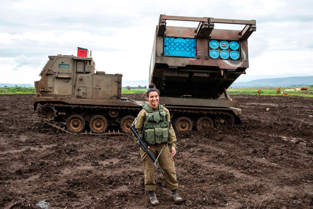Israeli army sergeant Amit Malekin, 19, commander of a mobile rocket launcher, poses for a picture in the Israeli-annexed Golan Heights near the border between Israel and Syria on February 26, 2018. (Photo by Jack Guez/AFP Photo)