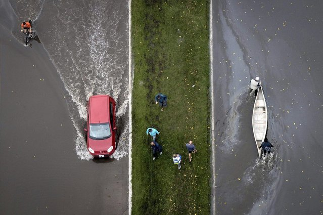 An aerial view of a boat and a car on a flooded street after heavy rains flooded a large part of the city, is pictured in La Plata April 3, 2013. At least 46 people were killed in Argentina on Wednesday after a torrential downpour battered the eastern city of La Plata and forced some 2,200 people to flee their homes in search of dry ground. (Photo by Reuters/Infobae.com)