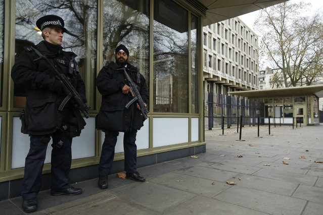 Police officers patrol outside the U.S. embassy in London December 9, 2014. The Senate Intelligence Committee prepared to release a report on the CIA's anti-terrorism tactics on Tuesday and U.S. officials moved to shore up security at American facilities around the world as a precaution. (Photo by Luke MacGregor/Reuters)