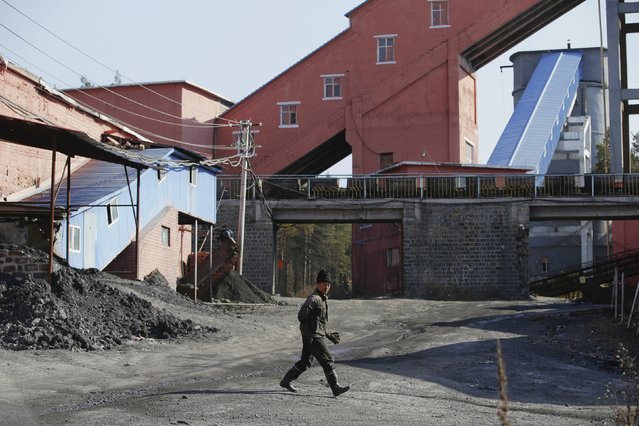 A miner walks at a coal mine from the state-owned Longmay Group on the outskirts of Jixi, in Heilongjiang province, China, October 24, 2015. (Photo by Jason Lee/Reuters)