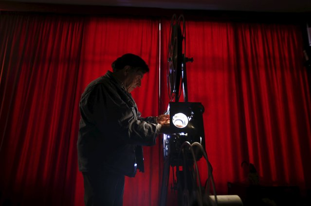 Projectionist Antonio Feliciano, 75, checks his projector before showing a film in Monforte, Portugal May 16, 2015. (Photo by Rafael Marchante/Reuters)