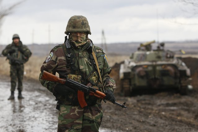 An Ukrainian serviceman guards at a checkpoint near the eastern Ukrainian town of Debaltseve in Donetsk region, December 24, 2014. (Photo by Valentyn Ogirenko/Reuters)