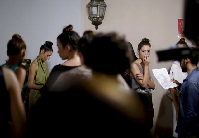 Models wait backstage to present creations by Balbina Arias during Andalucia de Moda (Andalusia Fashion) in Seville, southern Spain, November 10, 2015. (Photo by Marcelo del Pozo/Reuters)