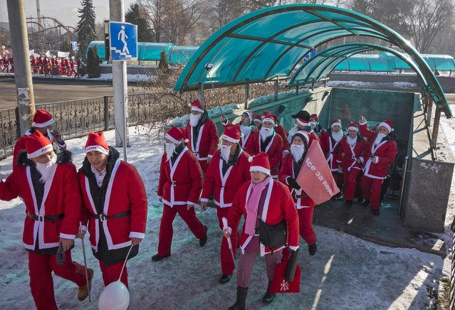 Revelers dressed as Father Frost, the equivalent of Santa Claus, walk out of an underpass during a parade in Almaty December 28, 2014. (Photo by Shamil Zhumatov/Reuters)