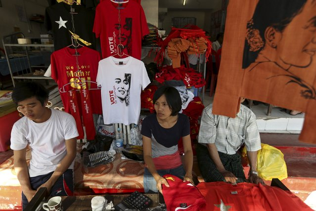 Party members sell shirts and bags with images of Myanmar pro-democracy leader Aung San Suu Kyi in front of the National League for Democracy party (NLD) head office in Yangon November 13, 2015. (Photo by Soe Zeya Tun/Reuters)