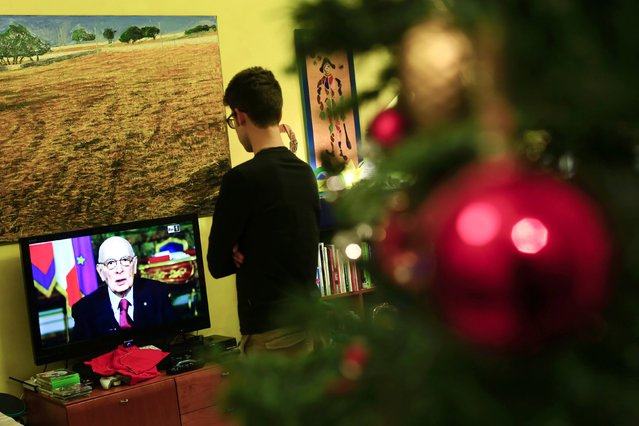 A man looks at the television as Italian President Giorgio Napolitano delivers his speech to Italians in Rome December 31, 2014. Napolitano said on Wednesday he planned to step down soon, leaving Prime Minister Matteo Renzi facing his most difficult political challenge since he took power about 10 months ago. (Photo by Tony Gentile/Reuters)