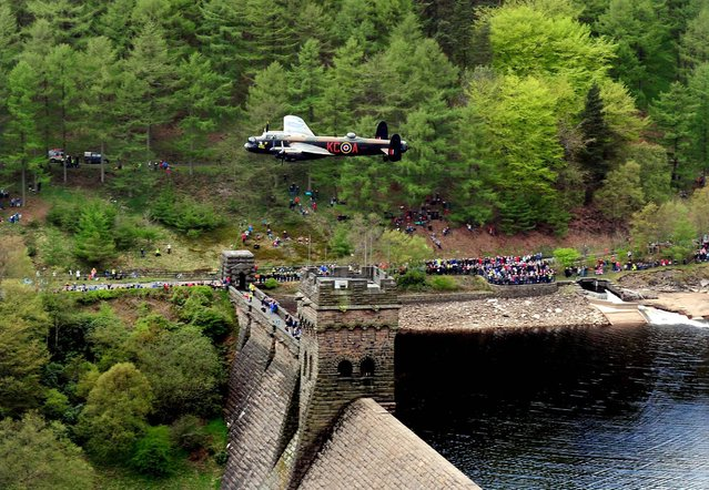 A Lancaster bomber during the Battle of Britain Memorial Flight performs a flypast over the Derwent Reservoir as part of a series of events to commemorate 70th anniversary of the Dambusters raid, May 16, 2013. (Photo by Rui Vieira/PA Wire)