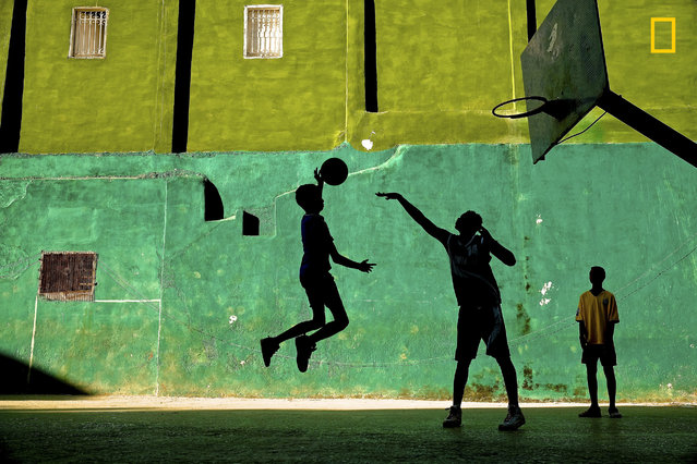 oung boys play basketball after school in a Havana neighborhood, Cuba. (Photo by Jeremy Lasky/National Geographic Travel Photographer of the Year Contest)