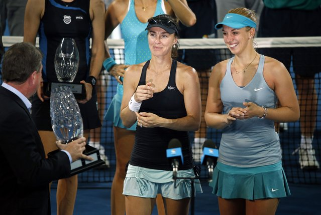 Martina Hingis (L) of Switzerland and Sabine Lisicki of Germany prepare to receive their trophy after winning the women's doubles final match at the Brisbane International tennis tournament in Brisbane, January 10, 2015. The pair defeated Caroline Garcia of France and Katarina Srebotnik of Slovenia to win the title. (Photo by Jason Reed/Reuters)