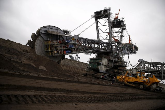 An excavator is seen at the Belchatow Coal Mine, biggest opencast mine of brown coal in Poland, outside of Belchatow Power Station (not pictured), Europe's largest coal-fired power plant  operated by PGE Group, near Belchatow, December 2, 2015. (Photo by Kacper Pempel/Reuters)