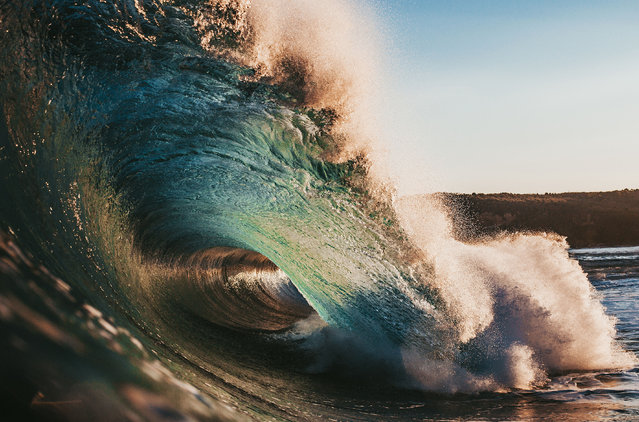 These kaleidoscopic images are the work of one persistent photographer's efforts to capture vibrant hues at the exact moment a wave breaks. Ryan Pernofski's stunning shots feature brilliant yellows, reds, blues and purples as an array of sunlight hits the water at the perfect time. What's even more impressive: Ryan, a 27-year-old Australian, began shooting his popular masterpieces without using a professional camera, taking his iPhone out into the water instead. Ryan began experimenting with this method in 2012, using an underwater housing to protect his phone, as he could not afford a professional camera. (Photo by Ryan Pernoski/Caters News Agency)