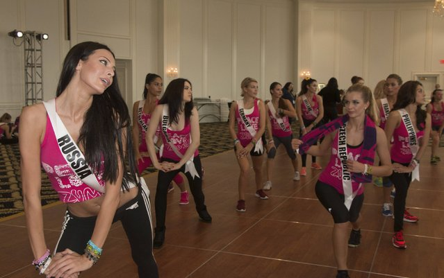 Miss Russia 2014 Yulia Alipova (L) leads a Zumba class for contestants during the 63rd annual Miss Universe Pageant in Miami, Florida in this January 13, 2015 handout photo provided by the Miss Universe Organization. (Photo by Reuters/Miss Universe Organization)