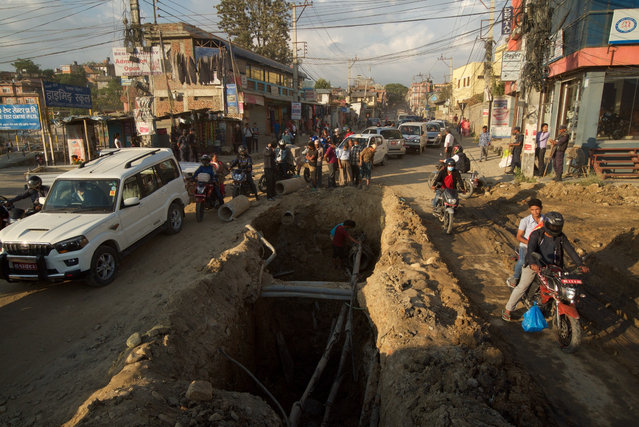 The widening of Kathmandu's ring road is at the heart of the programme and is seen as a driver for economic development. The government is now planning to build an outer ring road. (Photo by Pete Pattisson/The Guardian)