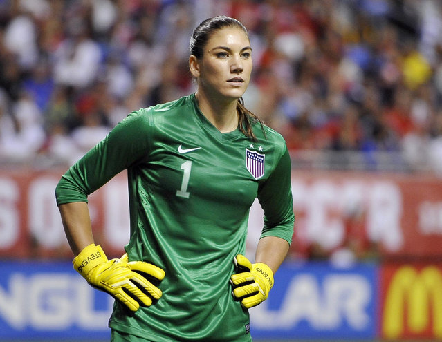 In this October 20, 2013, file photo, United States goalkeeper Hope Solo pauses on the field during the second half of an international friendly women's soccer match against Australia in San Antonio. Goalkeeper Hope Solo has been suspended from the U.S. women's national team for 30 days, Wednesday, Jan. 21, 2015. (Photo by Darren Abate/AP Photo)