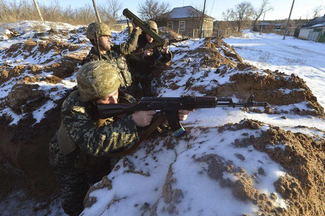 Ukrainian servicemen guard their position in the village of Luhanska, Luhansk region January 24, 2015. Eastern Ukraine has seen an escalation of fighting in recent days that Russian President Vladimir Putin has blamed on Kiev. (Photo by Oleksandr Klymenko/Reuters)