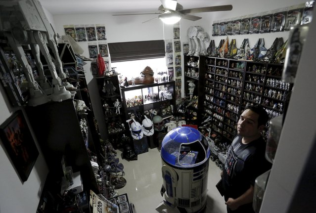 Mexican collector Pablo Perez, is seen next to a toy collection of Star Wars characters and items at his home in Monterrey, Mexico December 12, 2015. (Photo by Daniel Becerril/Reuters)