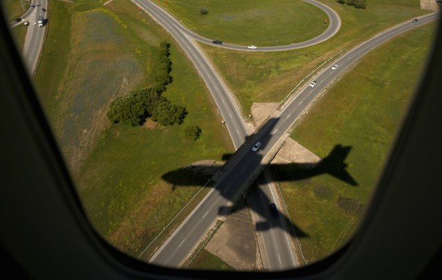 Air Force One casts a shadow upon its arrival in Austin, Texas in this April 10, 2014 file photo. (Photo by Kevin Lamarque/Reuters)