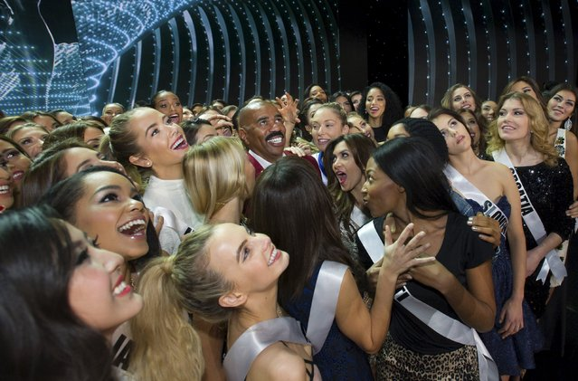 Comedian Steve Harvey (C) poses with the 80 contestants of Miss Universe 2015 in this handout photo provided by The Miss Universe Organization prior to rehearsal at the Planet Hollywood Resort & Casino in Las Vegas, Nevada, on December 19, 2015. (Photo by Darren Decker/Reuters/The Miss Universe Organization)