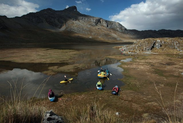 August 17, 2012 – Alpamarca, Peru – Raft and white water kayaks of the Amazon Express expedition set across Lago Acucocha after searching for the dry season source of the Amazon River. (Photo by Erich Schlegel/zReportage via ZUMA Press)